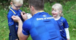 Leinster flanker Sean O'Brien signing an autograph for Fionn Kelly from Carlow at an event in Tullow RFC, Co Carlow where Bank of Ireland and Leinster Rugby announced a five year extension of their sponsorship through to the 2023 season. Looking on is Saorlaith Kelly. Photograph: Inpho/Tommy Dickson
