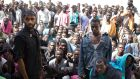 Migrants at a detention centre in Zawiyah, Libya, in 2015: there are claims Rome has been paying off Libyan warlords and militias linked to people-traffickers. Photograph: Tyler Hicks/New York Times
