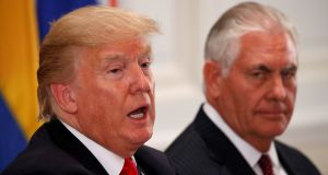US president Donald Trump with his secretary of state, Rex Tillerson, who has received a letter from 32 members of Congress, both Republic and Democrat, arguing that it is imperative that the US have a representative in Northern Ireland. Photograph: Kevin Lamarque/Reuters
