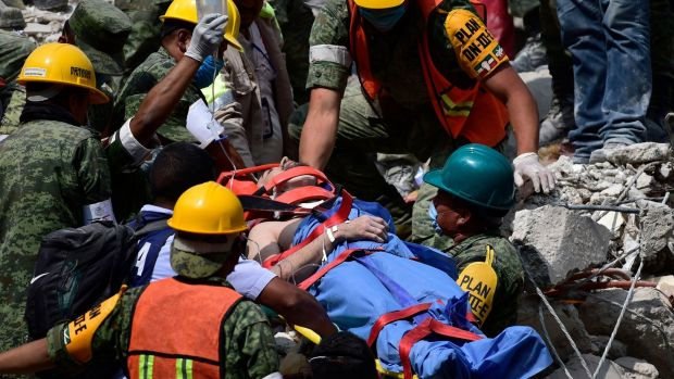 A man is pulled out of the rubble alive in Mexico City on Wednesday. Photograph: Mario Vazquez/AFP