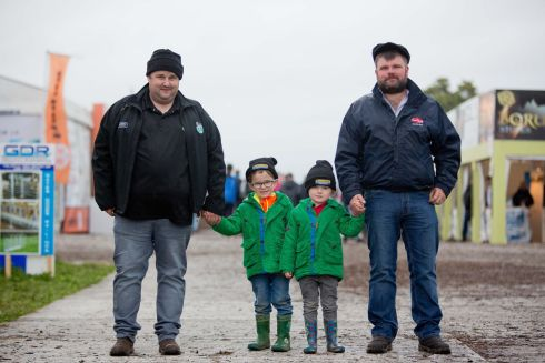 PJ Delaney, his sons Paddy, aged six, and Stephen, aged four, and their uncle Tom Callaghan, from Kilgarvan, Co Kerry