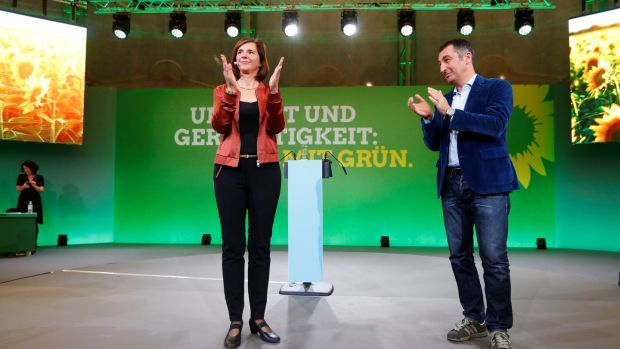 "Greens candidates Katrin Göring-Eckardt and Cem Oezdemir: ""If you want a stop sign for climate change, then you vote Green."" Photograph: Fabrizio Bensch/Reuters"