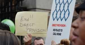 A 2014 protest against the direct provision system. Photograph: Alan Betson