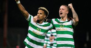 Celtic's Scott Sinclair celebrates scoring his side's first goal  with Leigh Griffiths during the Betfred Cup quarter-final against Dundee  at Dens Park. Photograph:  Jeff Holmes/PA Wire