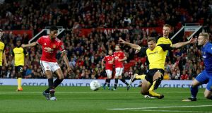 Manchester United's Marcus Rashford opens the scoring in the Carabao Cup third round game against Burton Albion at Old Trafford. Photograph: Andrew Yates/Reuters
