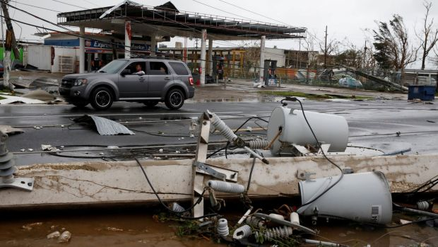 Damaged electrical installations are seen after the area was hit by Hurricane Maria en Guayama, Puerto Rico. Photograph: Reuters/Carlos Garcia Rawlins