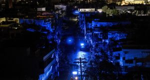 San Juan is seen during a blackout after Hurricane Maria made landfall on September 20th, 2017 in Puerto Rico. Thousands of people have sought refuge in shelters, and electricity and phone lines have been severely effected. Photograph: Alex Wroblewski/Getty Images