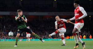 Arsenal's Jack Wilshere shoots at goal on his return  to action. Photograph: Eddie Keogh/Reuters