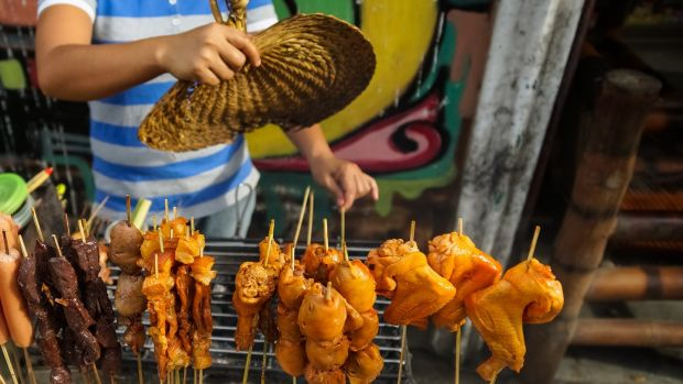 A street food cart in Manila. Photograph: Getty Images