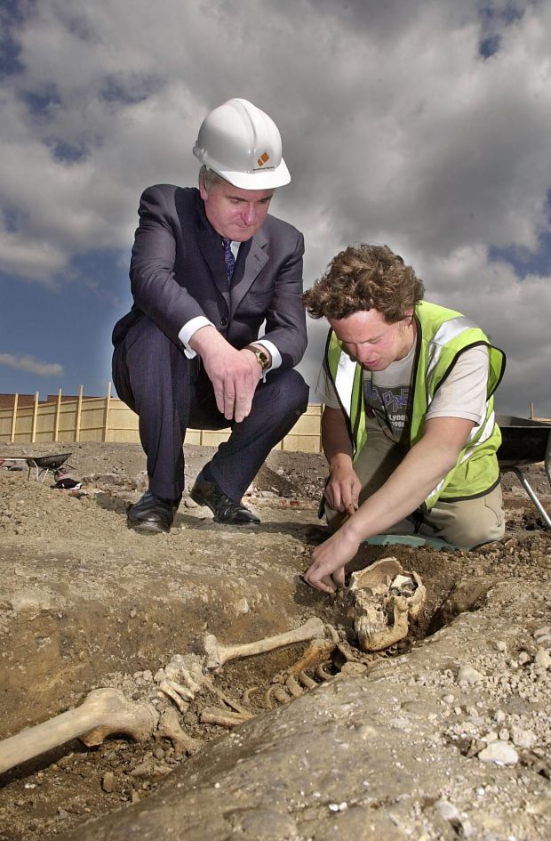 Bertie Ahern, with archaeologist Gary Bedford, and a 16th century skeleton on the site of the Smithfield Market Development. Photograph: Brenda Fitzsimons
