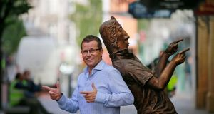 Paul Howard with the Ross O'Carroll-Kelly statue in Dublin city centre. Photograph Nick Bradshaw