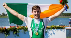 Ireland's Paul O'Donovan celebrates winning gold at the World Championships in Rotterdam. Photograph:  Herman Dingler/Inpho