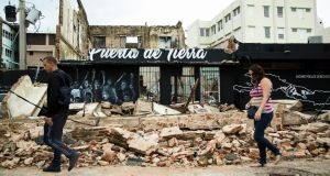 A collapsed building  in Old San Juan, Puerto Rico, on Thursday. Photograph: Erika P Rodriguez/NYT