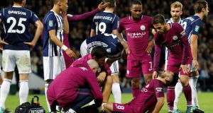 Manchester City's Ilkay Gundogan receives medical attention after sustaining an injury during the  Carabao Cup third-round game against West Brom. Photograph:  Darren Staples/Reuters