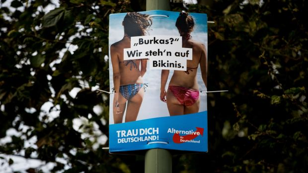 "A poster from the far-right AfD reads: ""Burkas? We prefer bikinis"". Photograph: Maja Hitij/Getty Images"