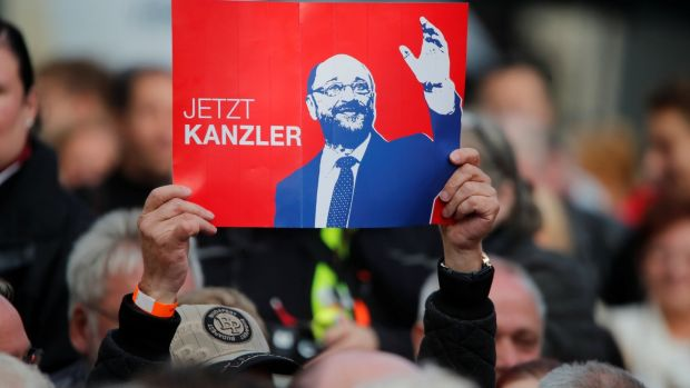 "A supporter of SPD leader Martin Schulz holds a placard reading ""Now chancellor"" during a campaign rally. Photograph: Wolfgang Rattay/Reuters"