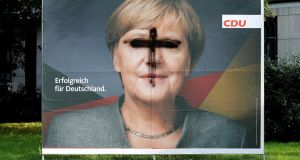 "A defaced election campaign poster of the CDU party in Cologne. Chancellor Angela Merkel offered voters her tried and trusted ""lot done, more to do"" campaign. . Photograph: Wolfgang Rattay/Reuters"
