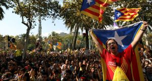 Protesters shout slogans and wave Catalan separatist flags outside the high court in Barcelona. Photograph: Susana Vera/Reuters