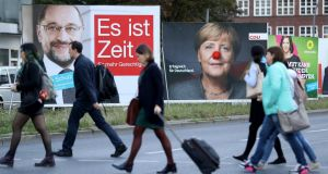 German Chancellor and Christian Democrat  Angela Merkel's face  is decorated with a red clown's nose on an election  billboard in Berlin ahead of the German election on September 24th. A board with the image of German Social Democrat  candidate Martin Schulz is on the left. File photograph: Sean Gallup/Getty Images