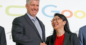 Google hardware executive Rick Osterloh  shakes hands with HTC chief executive Cher Wang during a news conference to announce Google's acquisition of HTC's Pixel smartphone division, in Taipei, Taiwan. Photograph: Tyrone Siu/Reuters.