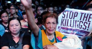 "Protesters    in Manila, Philippines: signs reading ""stop the killings"" and ""no to martial rule"" reflected concerns  that  President Rodrigo  Duterte would one day deliver on his threat to declare nationwide military rule.  Photograph: Francis R Malasig/EPA"