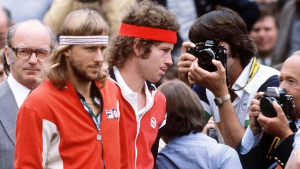 Björn Borg and John McEnroe enter the court for the 1980 Wimbledon men's singles final. Borg went on to win the title. Photograph: PA