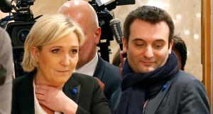 Marine Le Pen, French National Front leader, flanked by former vice-president Florian Philippot. Photograph: Charles Platiau/File Photo/Reuters
