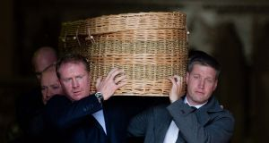 The coffin of Pat Geraghty being carried out by former Munster players Anthony Horgan and Ronan O'Gara at St Patrick's Church, Celbridge, Co Kildare. Photograph: Tom Honan