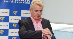 Michael O'Leary, chief executive officer of Ryanair, checks his watch ahead of the company's annual general meeting in Dublin on Thursday, September 21st. Photograph: Aidan Crawley/Bloomberg