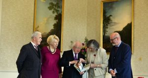 President Michael D Higgins and his wife Sabina receive representatives of Poetry Ireland to mark its 40th anniversary and Children's Books Ireland to mark its 20th anniversary, with from left; Theo Dorgan, Siobhan Parkinson and PJ Lynch at Áras an Uachtaráin.Photograph: Dara Mac Dónaill