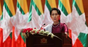 Aung San Suu Kyi delivering the speech in which she refused to criticise the military. Photograph: Ye Aung Thu/AFP/Getty Images