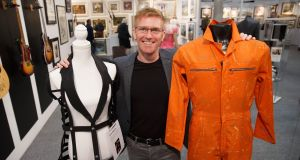 Laurence Carpenter with costumes worn by Madonna (€16,500) and David Bowie (€7,600)  for sale at the 52nd Irish Antique Dealers Fair at the RDS. Photograph: Fran Veale