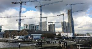 Construction in the Grand Canal Basin area of Dublin Docklands. Dublin faces a glut of offices if construction continues at current levels over the next three years