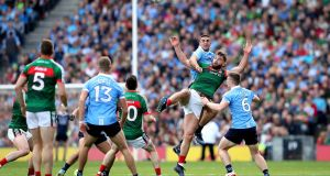 Dublin's James McCarthy battles with Mayo's Aidan O'Shea. Next summer brings the promise of more top-drawer clashes between the country's top eight sides. Photograph: Ryan Byrne/Inpho