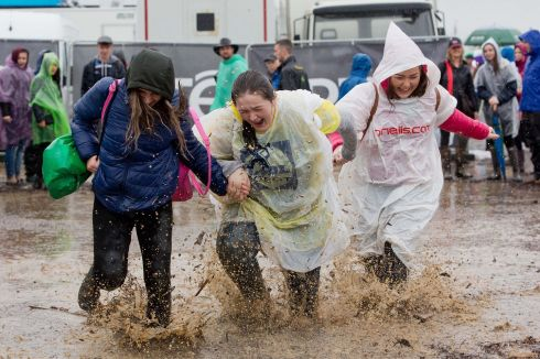 RAINY PLOUGH: From left are Rebecca Taylor, Nadine Kelly and Katie Flaherty, all from Ballinasloe, Co Galway, having fun in the rain at the National Ploughing Championships at Screggan, Tullamore, Co Offaly. Photograph:  Tom Honan