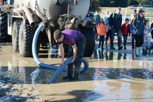 MUCKY ACTIVITY: The wet makes for muddy conditions underfoot on the third and final day of the National Ploughing Championships at Screggan, Tullamore, Co Offaly. Photograph: Alan Betson/The Irish Times