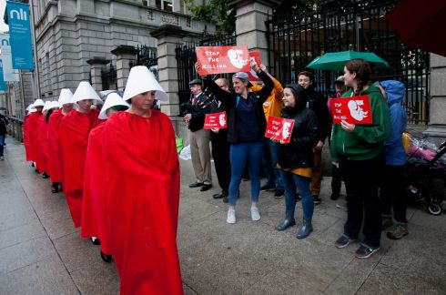 EIGHTH AMENDMENT: Reproductive Rights Against Oppression, Sexism & Austerity (Rosa) campaigners, dressed as Handmaids, mount a abortion pro-choice demonstration while passing by anti-abortion supporters  at Leinster House, Dublin, as the Oireachtas Committee on the Eighth Amendment began sitting. Photograph: Gareth Chaney/Collins