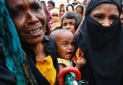 BABY CRIES: A Rohingya refugee baby cries as his mother jostles for humanitarian aid in Cox's Bazar, Bangladesh. Photograph: Danish Siddiqui/Reuters
