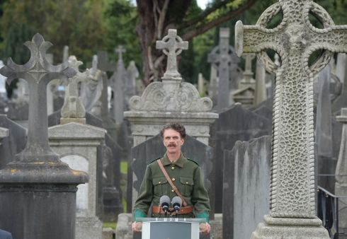 STATE COMMEMORATION Declan McCarthy, dressed as an Irish Volunteer, recites Let me Carry Your Cross for Ireland, Lord during  the State commemoration to mark the centenary of the death of Volunteers founder member Thomas Ashe at Glasnevin Cemetery. Photograph: Alan Betson/The Irish Times
