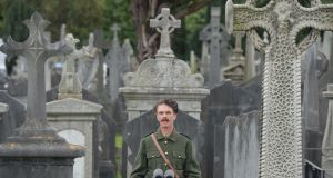 Declan McCarthy recites a poem while dressed as an Irish Volunteer during the State commemoration in Glasnevin Cemetery to mark the centenary of the death of Thomas Ashe. Photograph: Alan Betson/The Irish Times