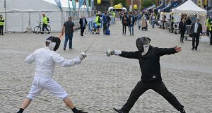Anthony Kelly and Dougal Hazel of Fence Fit duel on the Smithfield cobblestones  as Culture Night gets under way. Photograph: Dave Meehan/The Irish Times