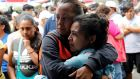 Women  embrace at a Mass given by Fr David Gimenez near a collapsed building after an earthquake earlier this week in Mexico City, Mexico. Photograph: Henry Romero/Reuters