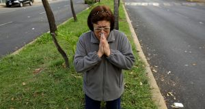 A woman prays after a tremor was felt in Mexico City, Mexico. Photograph: Jose Luis Gonzalez/Reuters