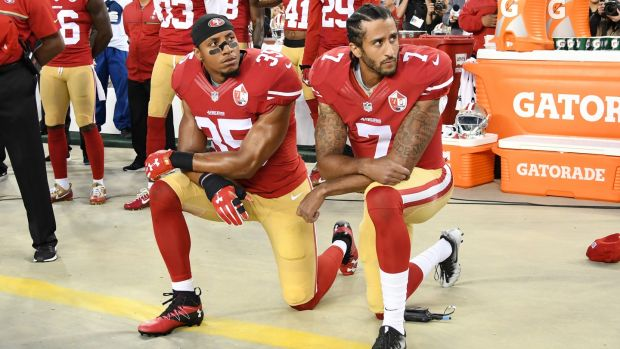 Eric Reid and Colin Kaepernick of the San Francisco 49ers kneel in protest during the American anthem.