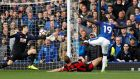 Everton's Oumar Niasse scores their first goal past Bournemouth's Asmir Begovic.  Photograph: Andrew Boyers/Reuters