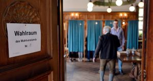 A voter arrives at a polling station in Schliersee, Germany, on Sunday. Photograph: Philipp Guelland/EPA
