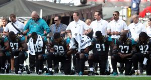Jacksonville Jaguars players kneel in protest during the US national anthem before the NFL International Series match against the Baltimore Ravens at Wembley Stadium in London. Photograph:   Simon Cooper/PA Wire