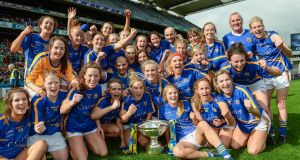Tipperary players celebrate with the cup. Photograph: Cody Glenn/Sportsfile
