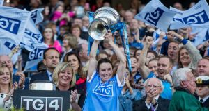 Dublin captain Sinéad Aherne lifts the Brendan Martin Cup after victory over Mayo in the TG4 Ladies Senior All-Ireland Football Championship Final at Croke Park. Photograph: Morgan Treacy/Inpho