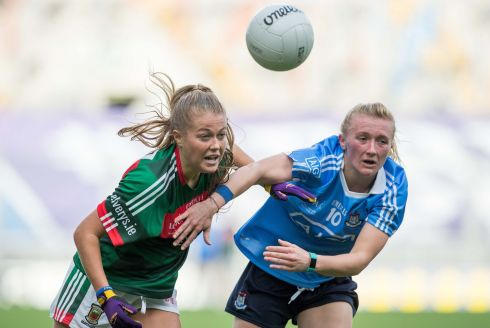 Sarah Rowe of Mayo and Dublin's Carla Rowe battle for possession. Photograph:  Morgan Treacy/Inpho